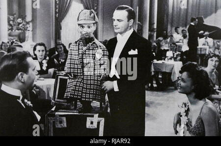1939 film 'Charlie McCarthy, Detective' starring Edgar John Bergen (1903 – 1978), an American actor, comedian and radio performer, best known for his proficiency in ventriloquism and his character Charlie McCarthy - Stock Photo