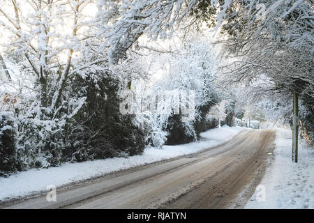 Lymington Bottom Road covered in thick snow, Medstead, Alton, Hampshire, England ,United Kingdom. - Stock Photo