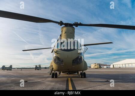 A CH-47 Chinook sits on Hunter Army Airfield prior to a sling load operation, Nov. 6, 2016. - Stock Photo