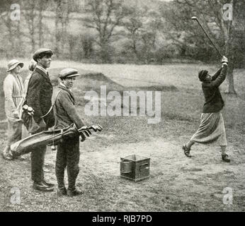 Men and women playing a round of golf on a course at Beaconsfield, Buckinghamshire. - Stock Photo