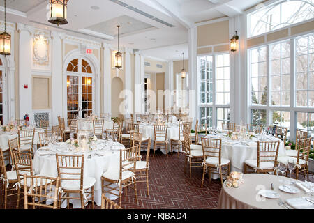 interior photo of wedding tables set for fine dinning during a wedding reception. part of a series of wedding decorations or restaurant table settings. - Stock Photo