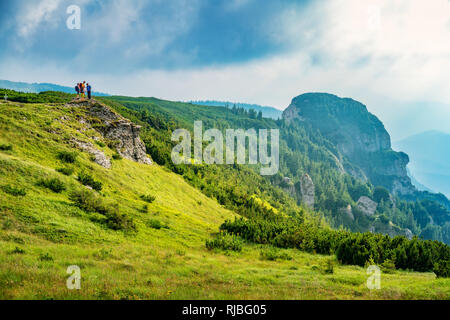 Hikers in the Ceahlau Massif, Carpathian Mountain Range, Romania. - Stock Photo