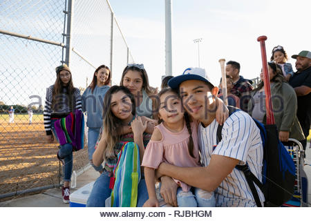 Portrait happy Latinx baseball player with family - Stock Photo