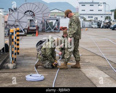 U.S. Navy Seabees, assigned to Underwater Construction Team (UCT) 2, make a bubble curtain at Commander, Fleet Activities Sasebo (CFAS), Jan. 15, 2018. UCT-2 provides construction, inspection, maintenance, and repair of underwater and waterfront facilities in support of the Pacific Fleet. - Stock Photo