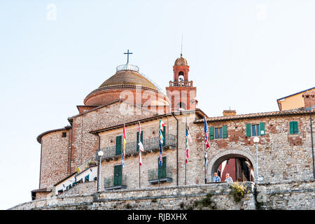 Castiglione del Lago, Italy - August 28, 2018: Medieval fortress fort wall in Umbria in sunny summer day cityscape with church tower and people by ent - Stock Photo