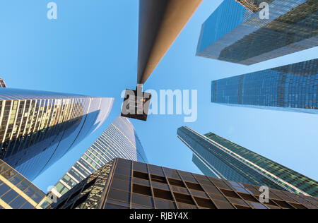 perspective bottom up view on business district skyscrapers Stock Photo