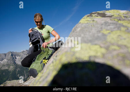Young woman hiking at the Aschaffenburger Höhenweg, Zillertal Alps, Tyrol, Austria - Stock Photo