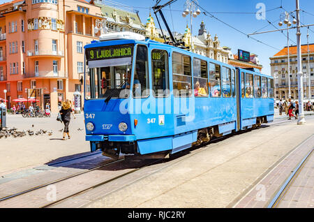 Square Ban Josip Jelacic with tourists and trams on a summer day in Zagreb. - Stock Photo