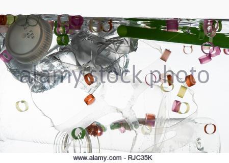 Aquarium With Plastic Pollution - Stock Photo