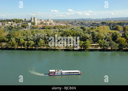 Panoramic View over Avignon and a Tourist Cruiser or Cruise Boat on the River Rhône Provence France - Stock Photo