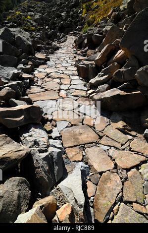 Stone Path or Stone Footpath in the Mercantour National Park French Alps France - Stock Photo