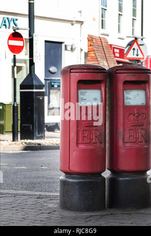 Two red post boxes on a street in the UK - Stock Photo