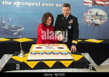 Busan, Republic of Korea (Jan. 11, 2018) Rear Adm. Michael E. Boyle, commander, U.S. Naval Forces Korea, and his wife, Tracy, cut a cake after the change of command ceremony at CNFK headquarters. Boyle relieved Rear Adm. Brad Cooper, becoming CNFK's 36th commander. - Stock Photo