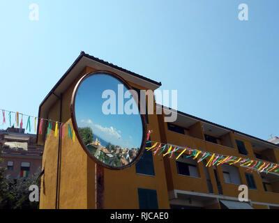 City reflection in a mirror, Porto Santo Stefano, Grosseto, Tuscany, Italy - Stock Photo