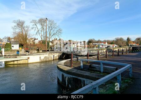 The River Thames at Sunbury Lock Surrey on a sunny winters day England UK - Stock Photo