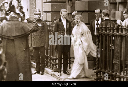 Lady Elizabeth Bowes-Lyon (1900-2002), later Duchess of York, then Queen Elizabeth, then Queen Mother, pictured leaving her parents' house in Bruton Street, London in her wedding dress to travel to Westminster Abbey for her marriage to Albert, Duke of York, the future King George VI. Her medieval style wedding dress was designed by Madame Handley-Seymour. - Stock Photo