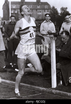 Roger Bannister of Great Britain (1929-2018), with a time of 3 mins 59.4 seconds, becomes the first person to run a mile in under 4 minutes, at the Iffley Road Sports Ground, England on 6th may 1954. - Stock Photo