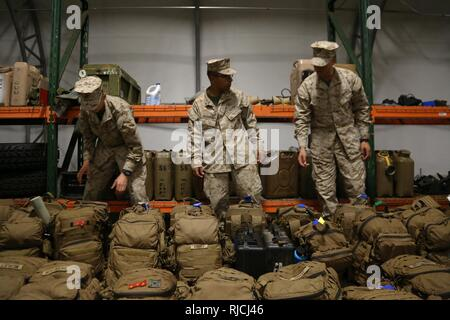Marines stage gear prior to their departure to Integrated Training Exercise 2-18 from Marine Corps Base Hawaii, Jan. 12, 2018. ITX 2-18 is the first iteration of the exercise to have participation from Marines with 3d Marine Regiment; 2d Battalion, 3d Marine Regiment; 1st Battalion, 12th Marine Regiment and Combat Logistics Battalion 3 together. - Stock Photo