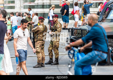 Firenze, Italy - August 30, 2018: Outside exterior of famous church in Florence Tuscany with military armed soldiers and many people - Stock Photo
