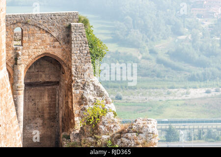 Orvieto, Italy Small historic medieval town village in Umbria with city walls fortress fort tower and nobody on cliff with view - Stock Photo