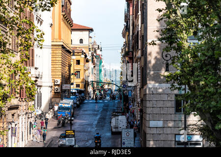 Rome, Italy - September 4, 2018: Streetscape cityscape of city town road Via Urbana sign and Piazza Esquilino park square framing of street in Rioni M - Stock Photo