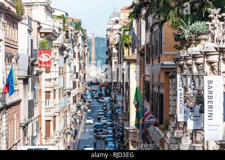 Rome, Italy - September 4, 2018: Historic city with church Santissima Trinita dei Monti column tower day by Spanish Steps between buildings narrow str - Stock Photo
