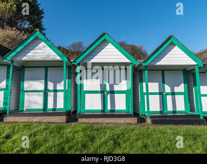 Swansea, South Wales UK 02/02/2019 Beach huts in Langland Bay, The Mumbles, Gower, South Wales,Very popular beach with families and tourists. - Stock Photo
