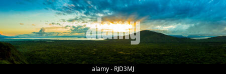 180 degree panorama of sunrise over the rain forest of Nechisar National Park, Ethiopia. - Stock Photo