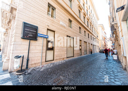 Rome, Italy - September 5, 2018: Italian street outside in historic city sunny day and sign for Louis Vuitton store on Via del Leoncino and Tomacelli  - Stock Photo
