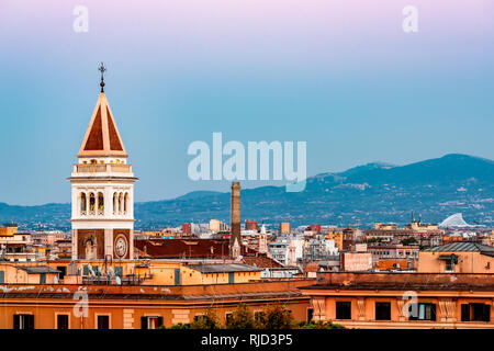Historic Italian town of San Lorenzo in Rome, Italy cityscape skyline with view of colorful architecture old buildings church tower at pink sunset nig - Stock Photo