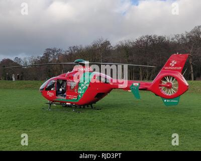 Newport Wales - January 22, 2019, An Airbus EC145 helicopter of the Wales Air Ambulance service after landing in Tredegar park on an emergency call. - Stock Photo