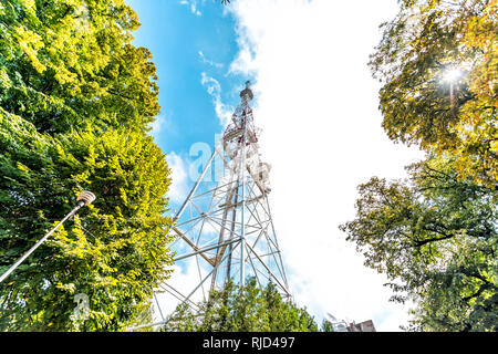 Lviv, Ukraine historic Ukrainian city old town building during sunny summer day on High Castle Hill Television Tower with green trees and clouds low a - Stock Photo