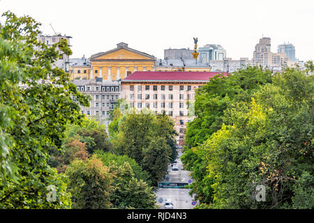 Kyiv, Ukraine - August 12, 2018: High angle view of Kiev street road in summer Peter's alley with trees and cars in traffic sign with cityscape of Mai - Stock Photo