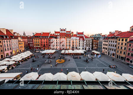 Warsaw, Poland - August 22, 2018: Old town market square with historic cobblestone street during summer day view of old market square in town cafe res - Stock Photo