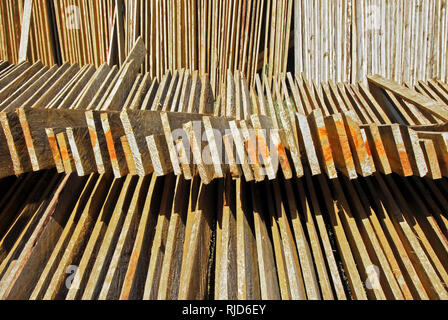 Cut and marked pine wood planks layed-out for drying in the sun, seen near Sagada Town, Mountain Province, Philippines - Stock Photo