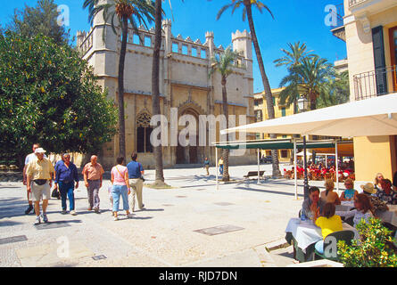 Terrace and tourists by the Lonja building. Palma de Mallorca, Spain. - Stock Photo