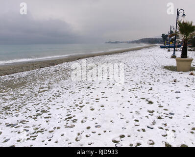 Beach covered with snow in Pieria Greece - Stock Photo