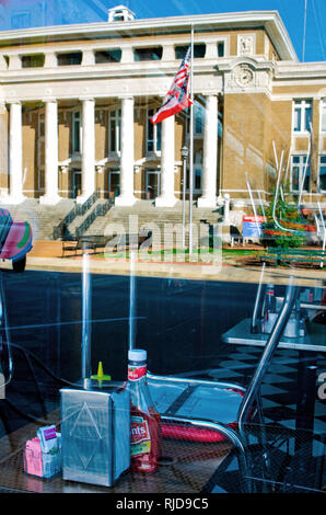 The Alcorn County Courthouse is reflected in the window of Borroum's Drug Store on Waldron Street in Corinth, Mississippi, Feb. 26, 2012. - Stock Photo