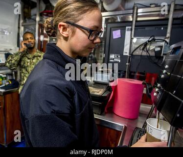 NORFOLK, Va (Jan. 22, 2018) Aviation Ordnanceman Airman Sarah Boone operates an espresso machine aboard the aircraft carrier USS George H.W. Bush (CVN 77). The ship is in port in Norfolk, Virginia, conducting routine maintenance in preparation for the Board of Inspection and Survey (INSURV). - Stock Photo