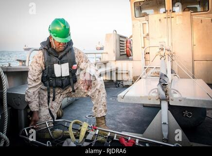 FUJAIRAH, United Arab Emirates (Jan. 17, 2018) Hospital Corpsman 1st Class Michael Shepherd, assigned to 3rd Marine Aircraft Wing, conducts checks for a medical evacuation drill during Native Fury 18. The exercise is designed to train Special Purpose Marine Air-Ground Task Force-Native Fury Marines and U.S. Navy Sailors in maritime prepositioning force operations and aims to increase proficiency, expand levels of cooperation, enhance maritime capabilities, and promote long-term regional stability and interoperability between the United Arab Emirates and the U.S. - Stock Photo