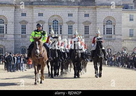 Police escort for the Queens Lifeguards on Horse guards Parade London - Stock Photo