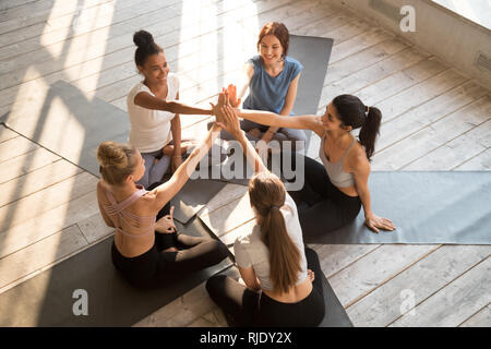 Top view of women give high five motivated after training - Stock Photo