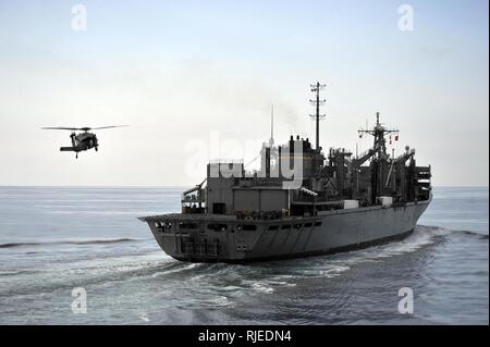 U.S. 5TH FLEET AREA OF RESPONSIBILITY (Dec. 19, 2012) An SH-60B Sea Hawk helicopter assigned to the Eightballers of Helicopter Sea Combat Squadron (HSC) 8 approaches the Military Sealift Command fast combat support ship USNS Bridge (T-AOE 10). - Stock Photo