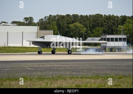 NAVAL AIR STATION PATUXENT RIVER, Md. (May 14, 2013) The X-47B Unmanned Combat Air System (UCAS) demonstrator lands at Naval Air Staion Patuxent River, Md., after completing the first launch of an unmanned aerial vehicle from an aircraft carrier. - Stock Photo