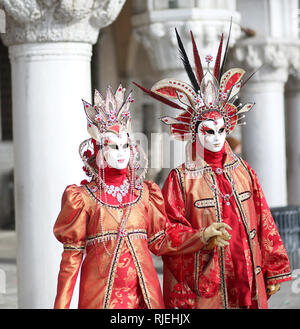 Venice, VE, Italy - February 5, 2018: man and woman with great masks at the Venice Carnival in Saint Mark Square - Stock Photo