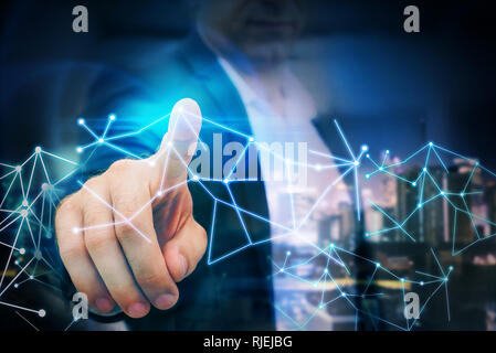 Business man point finger to global futuristic technology network - Stock Photo