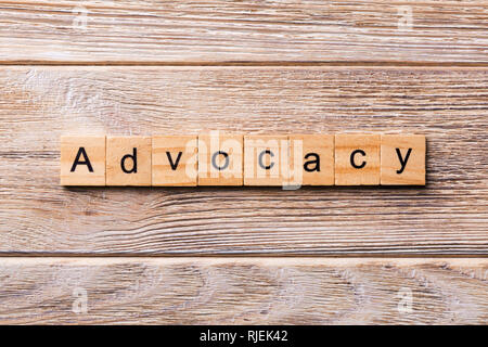 ADVOCACY word written on wood block. ADVOCACY text on wooden table for your desing, concept.
