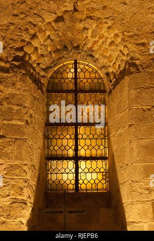 Window on the corridor wall inside Mont Saint-Michel abbey, Normandy coast, France - Stock Photo