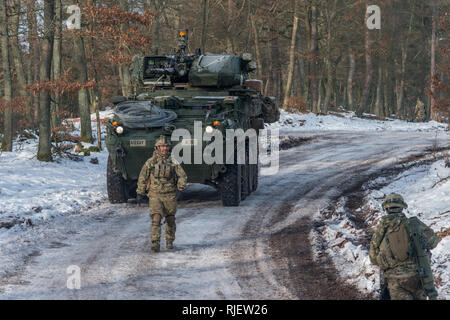 Soldiers assigned to Alpha Troop, 1st Squadron, 2d Cavalry Regiment from  Vilseck, Germany, prepare for a situational training exercise in Area B of  the Baumholder Military Training Area, Baumholder, Germany, Feb. 4 , 2019.  1/2CR is currently conducting Operation Kriegsadler to develop platoon-level  tactical proficiency, squadron support effectiveness and overall  organizational lethality. (U.S. Army photo by Erich Backes). - Stock Photo
