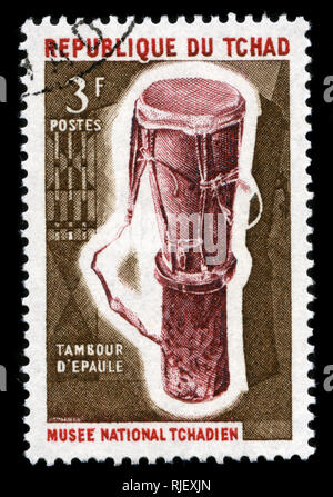 Postmarked stamp from Chad in the Musical instruments series issued in 1965 - Stock Photo